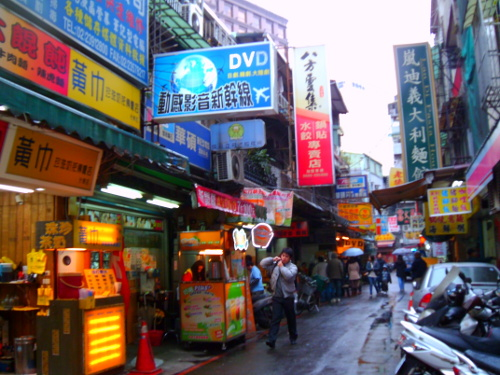 Street stalls selling typical Taiwanese street food mix with the technology stores