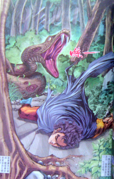 Yang Guo, passed out, is about to be attacked by a giant snake.
