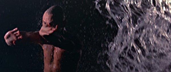 Gordon Liu punches a curtain of water