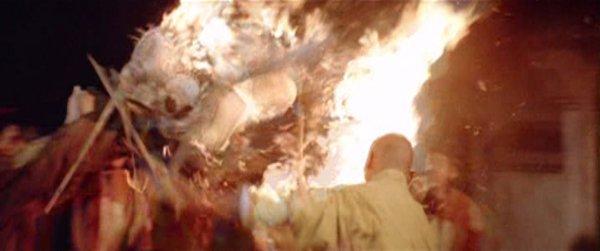 San Te burns the goons with the lanterns.