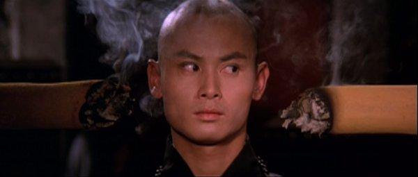 San Te's head between two incense sticks.