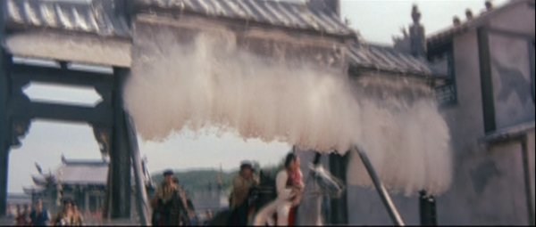 The flour starts to fall from the gate onto the horse riders.