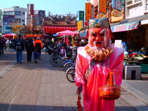 A Taiwanese deity walks in the street