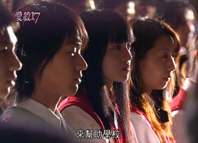 Yizhen and Jiawei in the special school assembly announcing Yijing's death