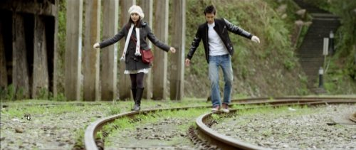 Ko Ching-teng and Shen Chia-yi walk the train tracks of Jingtong