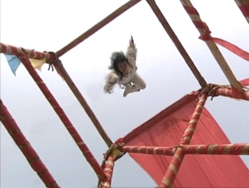 Di Yun flies down through the collapsing stand.
