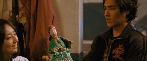 Ah Hua shows Yi-nan a budaixi puppet