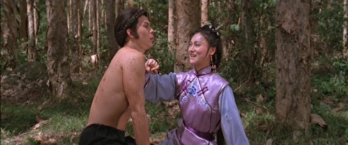 Yuan Ziyi has her knife at Hu Fei's throat - how romantic.