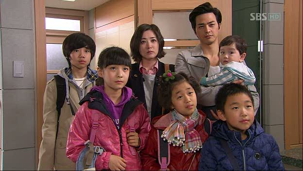 Pal Kang, the Cranky Lawyer, and a Gaggle of Children.
