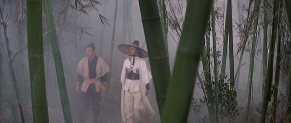 Leng Yushang and Changchun walk through a misty bamboo forest.