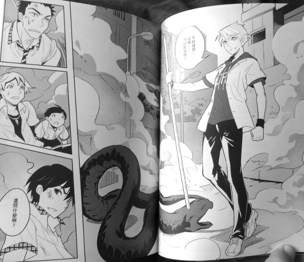 SURPRISE! Fellow senior high school student nabs demon.  There is a big, clear panel showing the main action, with supporting panels with reaction shots.  Also, notice that the demon hunter is erect and vertical, while the demon is horizontal, making a nice right-angle.