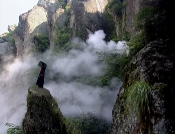 Shenggu stands among mist-filled mountains
