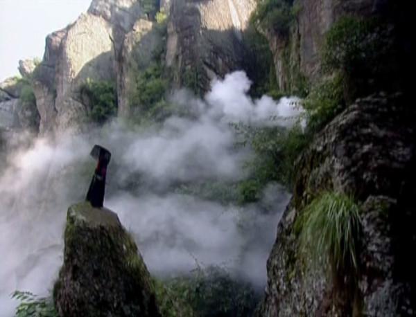 Shenggu stands among mist-filled mountains