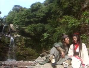 Linghu Chong and Ren Yingying sit by a waterfall