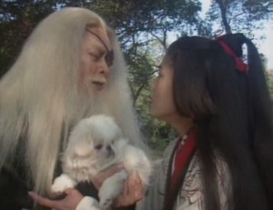 Ren Woxing holds a puppy in his arms as Ren Yingying rushes up to him.